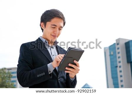 young man working on a mobile touchscreen tablet computer