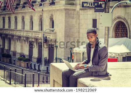 stock-photo-young-man-working-on-street-a-young-black-college-student-is-sitting-outside-working-on-a-laptop-198212069.jpg