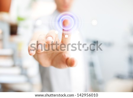 Young man working with virtual screen - stock photo
