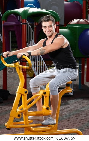 Young man workout on a fitness machine