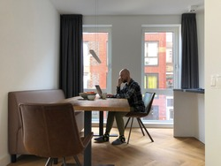 young man works from home.  Europeans were advised not to go to the office and work from home. we encourage staff to work from home as much as possible.
