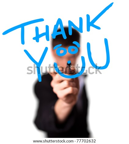 Young man writing Thank YOU on whiteboard, selective focus - stock photo