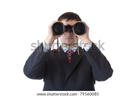 Young manager looks through binoculars and searches for business.Isolated on white background