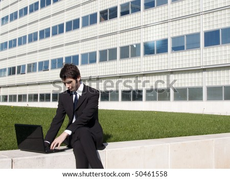 Young manager working outdoors the corporate garden