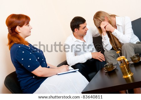Young married couple consults at the psychologist - stock photo