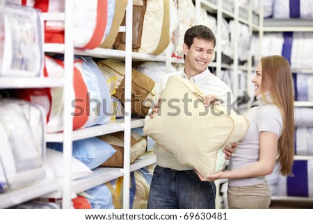 Young married couple shopping in a store