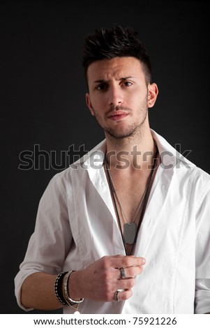 Young masculine handsome man on a black background