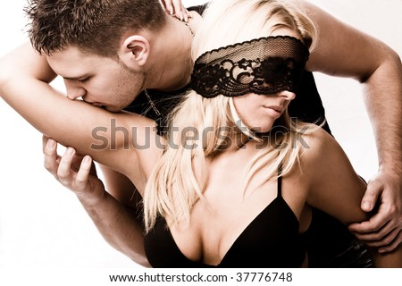young masked couple in love, studio shot on white