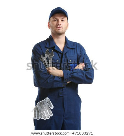 Young mechanic in uniform with a wrench and gloves in pocket, isolated on white #491833291