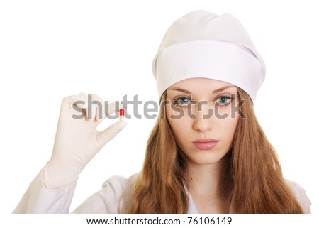 young medical doctor with red pills in hands on white background