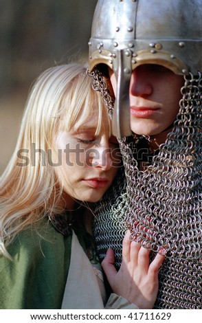Young medieval couple, strong soldier and maid