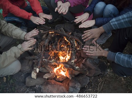 young men and women hands warm...