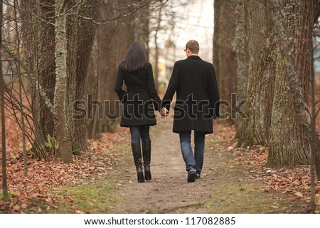 young men and women leaving the path in the park