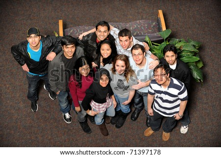 Young men and women of diverse ethnic groups standing together