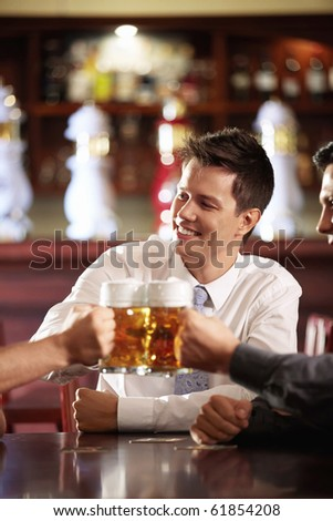 Young men bob mug of beer in a pub