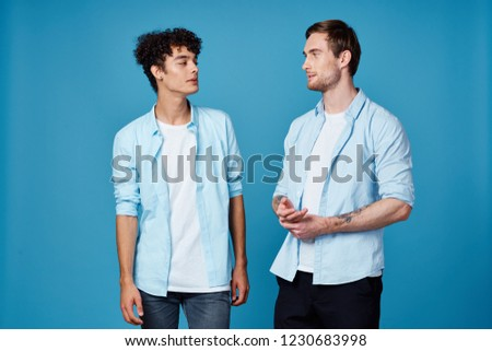 young men in  shirts on a blue background