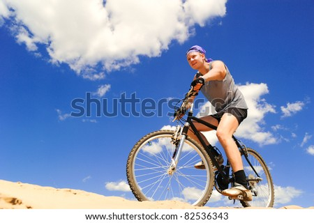 Young men  riding a bike downhill style