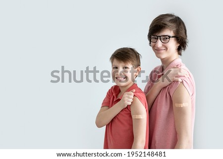 Young men, teenager and boy vaccinated against coronavirus infection. Vaccination against covid-19. Sputnik-V. Copy space.