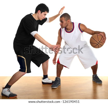 Young men - white and mulatto - playing basketball on wooden floor.