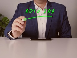 young Merchant writing ROTH IRA individual retirement account with marker in the office