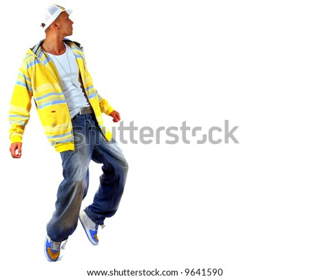 Young Michael Jackson Young man with clothes in hip-hop style showing a dance move while jumping over pure white background.