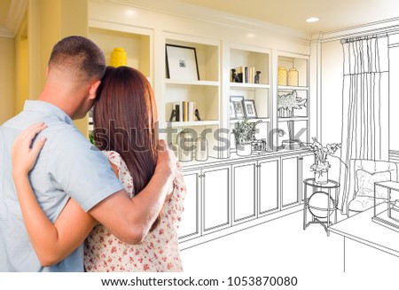 Young Military Couple Facing Custom Built-in Shelves and Cabinets Design Drawing Gradating to Finished Photo.