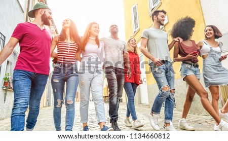 Young millennials friends walking in city old town center - Happy people having fun together - Youth lifestyle, generation z and friendship concept - Main focus on left girl face