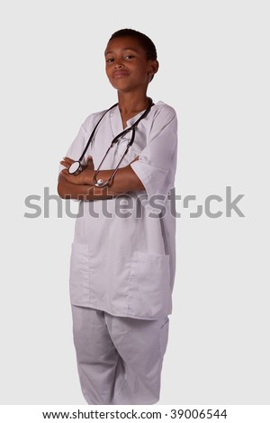 Young mixed race black ethnic boy wearing white scrubs uniform with stethoscope - stock photo