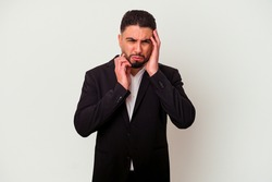 Young mixed race business man isolated on white background whining and crying disconsolately.