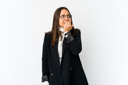 Young mixed race business woman isolated on white background biting fingernails, nervous and very anxious.