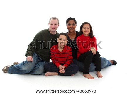 Young mixed race family on a white background
