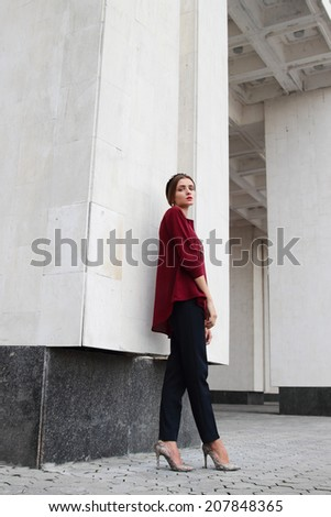 Young model girl in classic clothes