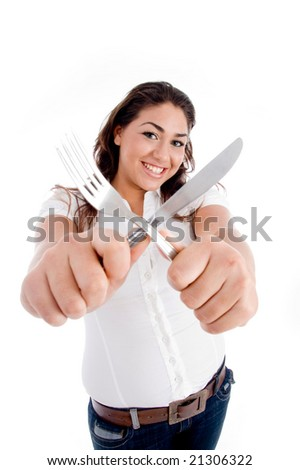 young model holding fork and knife on an isolated white background - stock photo