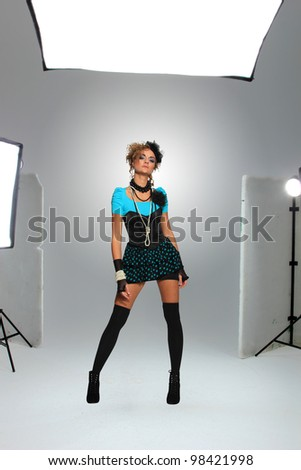Young model in photographer's studio getting her beauty shots done