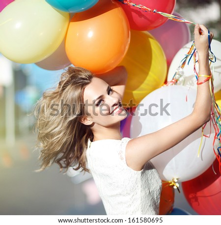 Young model woman smile with balloons