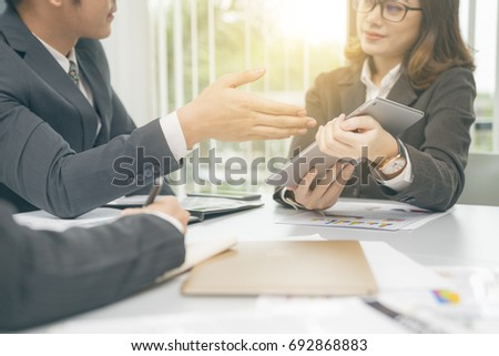 Young modern asian woman present project for boss.Working woman concept. #692868883
