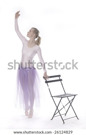 Young modern ballet dancer posing on a white background