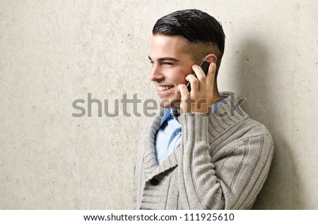 young modern business man with a mobile phone