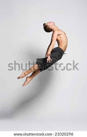 young modern dancer posing over white background