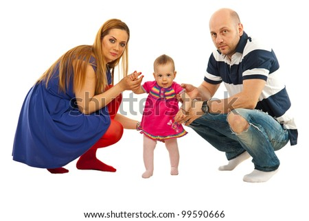 Young modern parents holding their daughter baby to make first steps isolated on white background - stock photo