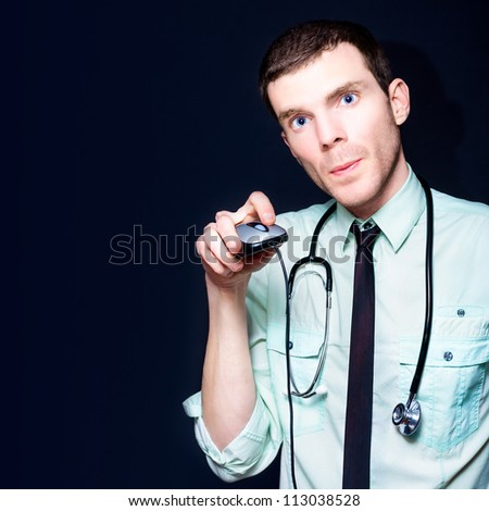 Young Modern Professional Doctor Holding Computer Mouse While Searching The Internet For New Age Health Care