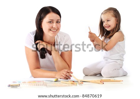 Young mom and her little daughter draw pencils. Isolated