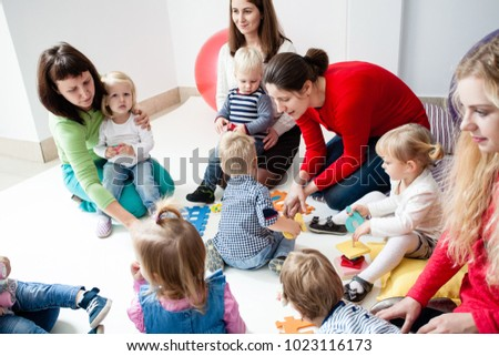 Young moms with their kids