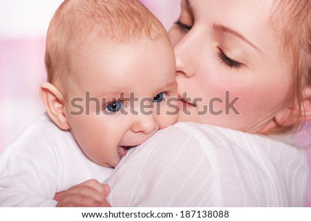 Young mother aged 25 to 30 years holding baby