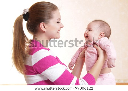 young mother and baby at home