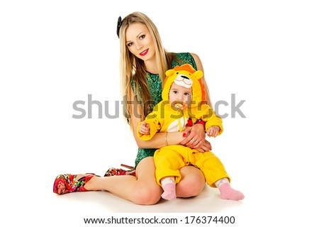 Young mother and baby in a lion costume