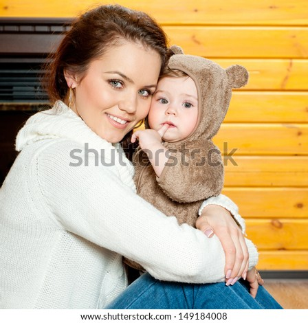 young mother and baby in home interior