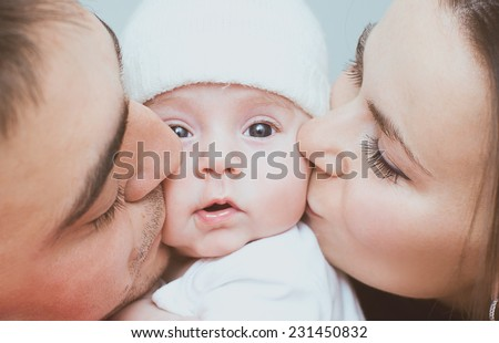 Young mother and father with newborn