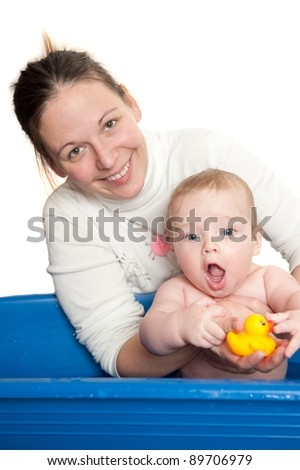 young mother and her cute baby in the bath, isolated on white background