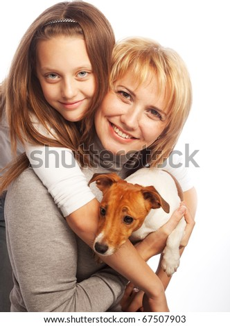 Young mother and her daughter with Jack Russell Terrier. over white background